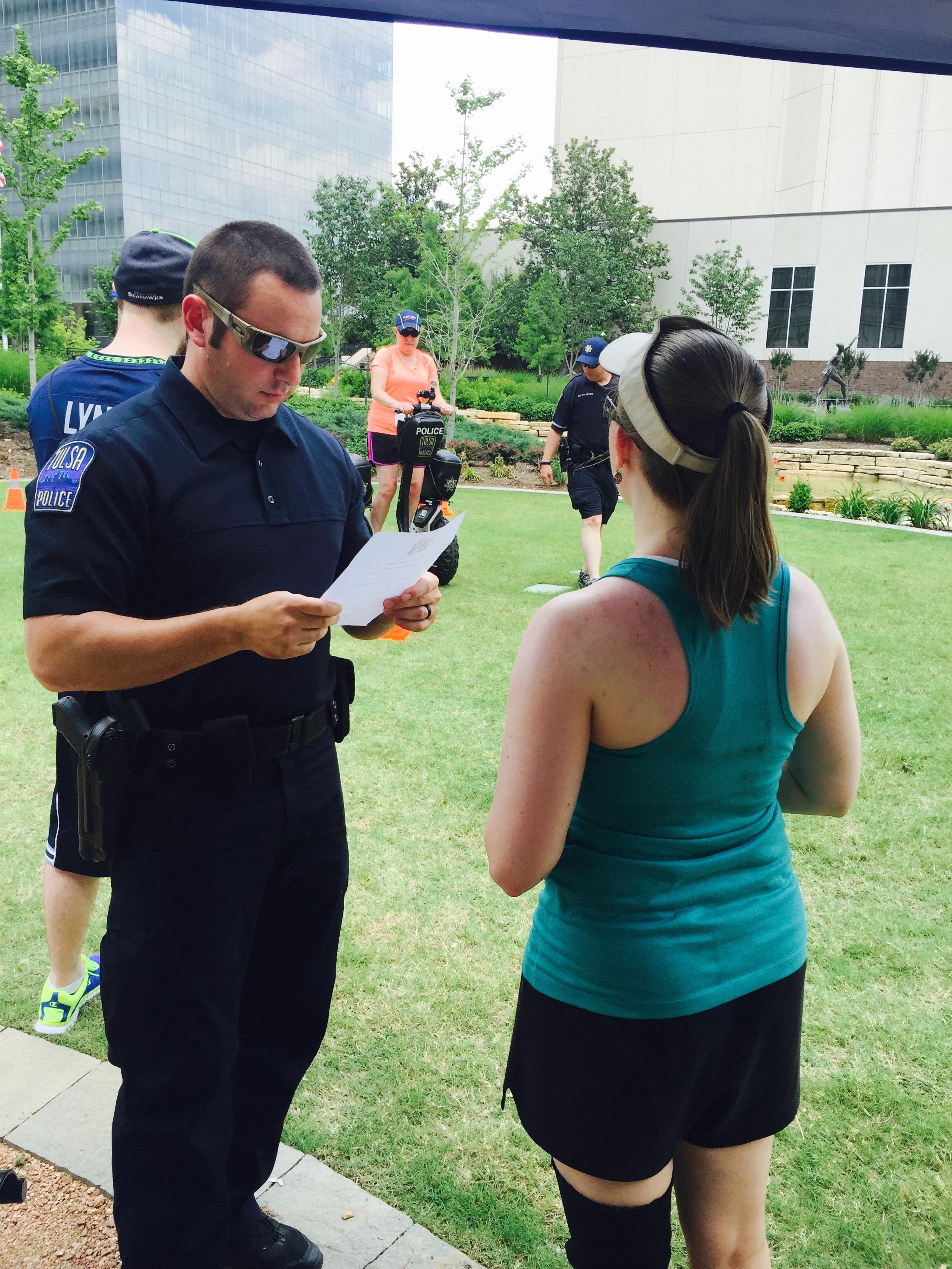 Ashley Reciting Miranda Rights to Police Officer